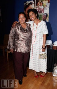 Actress Sophie Okonedo embraces real-life Sandra Laing.