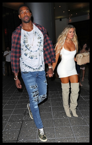 Tristan Thompson and Khloe Kardashian holding hands in Miami.